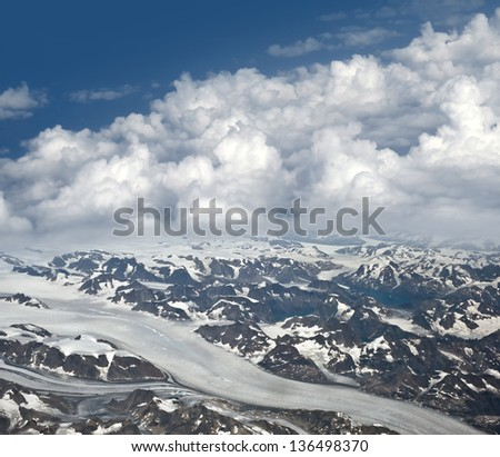 Greenland - aerial view of mountains and glacier - stock photo