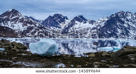 Greenland Fjord with Sea Ice and Boat - stock photo