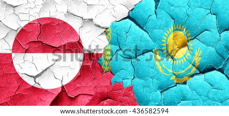 greenland flag with Kazakhstan flag on a grunge cracked wall