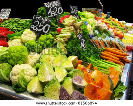 Greens and vetegatbles at the market stall - stock photo