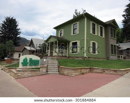 Greenwood Spring, CO - JULY 1: The Green Joint Marijuana Shop and sign in Greenwood Springs in Colorado, USA.  July 1, 2015. - stock photo