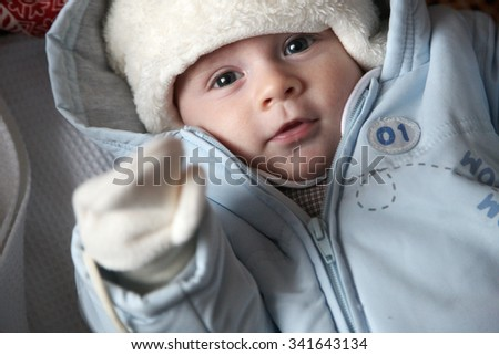 Greeting baby, closeup portrait of an adorable newborn - stock photo