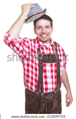 Greeting bavarian man with leather pants and traditional hat - stock photo