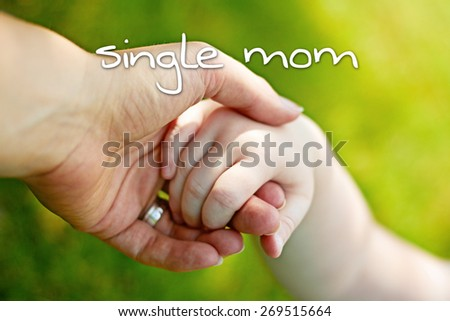 greeting card background - hands of mother and child - single mom - stock photo