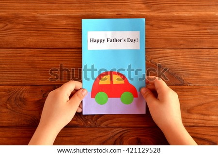 Greeting card father's day. Child holds a greeting card in his hand. Happy father's day. Easy kids crafts  - stock photo