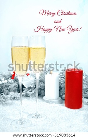 Greeting card for Christmas and New Year celebration with champagne glasses and candles