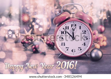 """Greeting card """"Happy New Year 2016!"""" with vintage clock and sparkling decorations. This image is toned. Shallow DOF, focus on the clock - stock photo"""