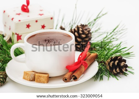 Greeting Card Merry Christmas, Happy New Year, the composition of the hot chocolate, gift, cinnamon, pine cones, pine twigs isolated on white background - stock photo