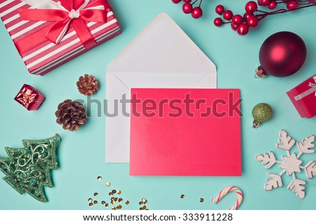 Greeting card mock up template with Christmas decorations. View from above - stock photo