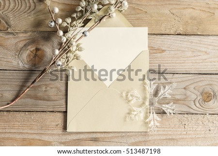 Greeting card mock up, with gold envelope on wooden background.