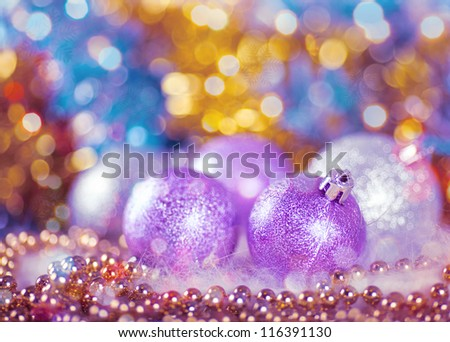 Greeting card with Christmas balls in bright lilac design - stock photo