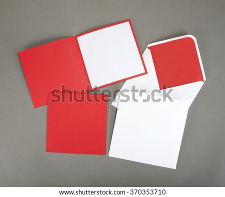 Greeting card with envelope on gray background