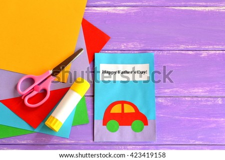 Greeting card with message Happy father's day. Father's day crafts cards ideas suitable for preschool, kindergarten and gradeschool kids. Sheets of paper, scissors, glue on lilac wooden background  - stock photo