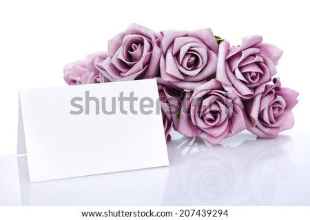 Greeting card with purple flowers on a white background, place for text - stock photo