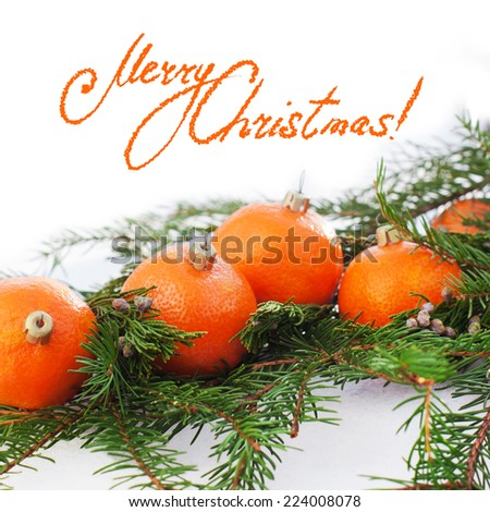 Greeting Card with Tangerines as Fir-tree Toy and Branch of Coniferous on White Snow, with top part isolated on white - stock photo