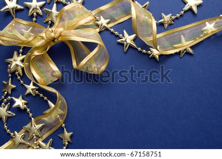 Greeting cards and gold stars on blue paper. Natural Textures