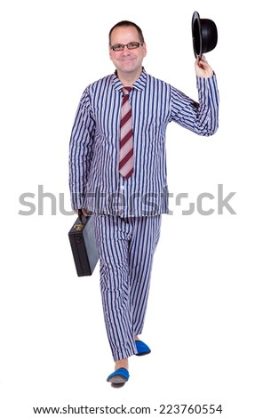 greeting man in pajamas with suitcase  - stock photo