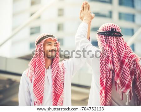 Greeting arab businessman modern city successful stock photo greeting of arab businessman in the modern city successful happy good feeling m4hsunfo