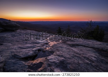 Greeting the sun from the Beacon Heights Overlook right off the Blue Ridge Parkway in North Carolina. - stock photo