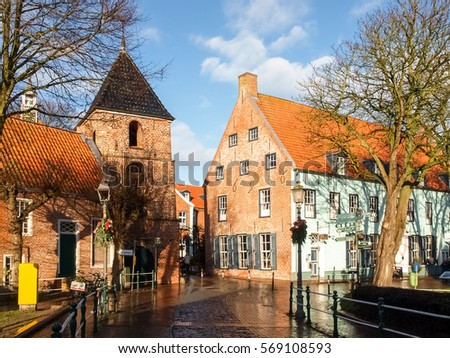 Greetsiel, Germany - December 6, 2014: Tourist town maintained as in antiquity. The typical houses are built of red brick. In the village there is a small harbor.