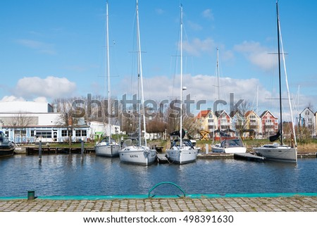 GREIFSWALD, GERMANY - APRIL 2, 2015: Harbour on the river Ryck, yachts moored at the pier. West Pomerania
