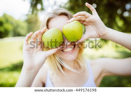 gren apples.smiling woman with apple, outdoors, Healthy eating concept.Close up - stock photo
