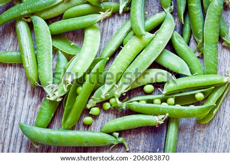 Gren peas on a wooden background close up