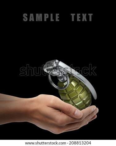 Grenade. Man hand holding object  isolated on black background. High resolution - stock photo
