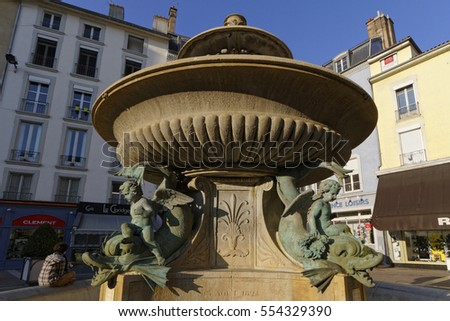 GRENOBLE, FRANCE, December 28, 2016 : Fountain of dolphins in Place Grenette.