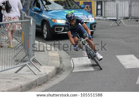 "GRENOBLE, FRANCE - JUN 3: Professional racing cyclist Andrey Amador rides UCI WORLD TOUR ""CRITERIUM DU DAUPHINE LIBERE"" time trial on June 3, 2012 in Grenoble, France. Luke Durbridge wins the stage - stock photo"
