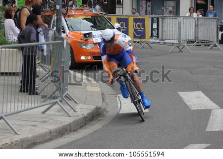 """GRENOBLE, FRANCE - JUN 3: Professional racing cyclist Bram Tankink rides UCI WORLD TOUR """"CRITERIUM DU DAUPHINE LIBERE"""" time trial on June 3, 2012 in Grenoble, France. Luke Durbridge wins the stage - stock photo"""