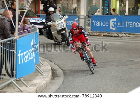 "GRENOBLE, FRANCE - JUN 8: Professional racing cyclist Cadel Evans rides UCI WORLD TOUR "" CRITERIUM DU DAUPHINE LIBERE"" third stage time trial on June 8, 2011 in Grenoble city, Isere, France. - stock photo"