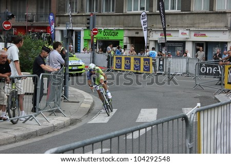 """GRENOBLE, FRANCE - JUN 3: Professional racing cyclist Federico Canuti rides UCI WORLD TOUR """" CRITERIUM DU DAUPHINE LIBERE"""" time trial on June 3, 2012 in Grenoble, France. Luke Durbridge wins the stage - stock photo"""