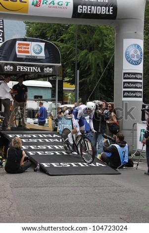"""GRENOBLE, FRANCE - JUN 3: Professional racing cyclist Jerome Coppel rides UCI WORLD TOUR """"CRITERIUM DU DAUPHINE LIBERE""""  time trial on June 3, 2012 in Grenoble, France. Luke Durbridge wins the stage - stock photo"""