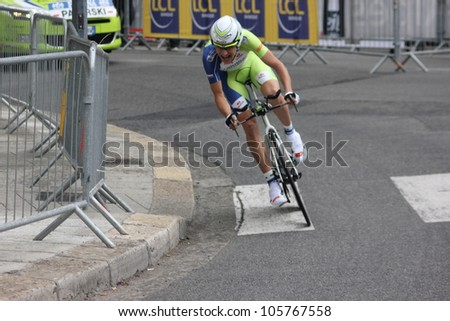 """GRENOBLE, FRANCE - JUN 3: Professional racing cyclist Maciej Paterski rides UCI WORLD TOUR """"CRITERIUM DU DAUPHINE LIBERE"""" time trial on June 3, 2012 in Grenoble, France. Luke Durbridge wins the stage - stock photo"""