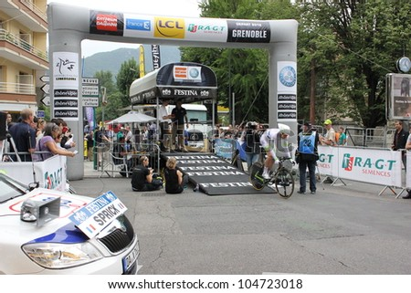 """GRENOBLE, FRANCE - JUN 3: Professional racing cyclist Matthieu Sprickl rides UCI WORLD TOUR """"CRITERIUM DU DAUPHINE LIBERE  time trial on June 3, 2012 in Grenoble, France. Luke Durbridge wins the stage - stock photo"""