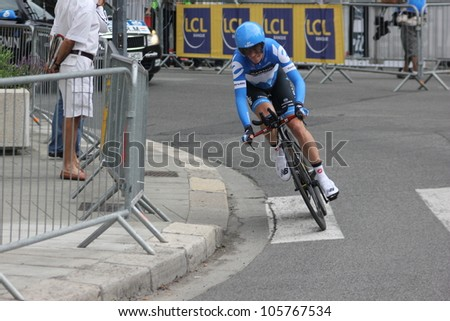 """GRENOBLE, FRANCE - JUN 3: Professional racing cyclist Michel Kreder rides UCI WORLD TOUR """"CRITERIUM DU DAUPHINE LIBERE"""" time trial on June 3, 2012 in Grenoble, France. Luke Durbridge wins the stage - stock photo"""