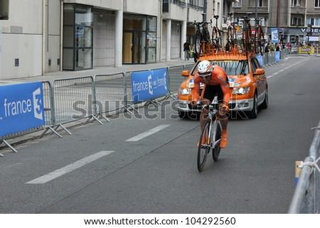 "GRENOBLE, FRANCE - JUN 3: Professional racing cyclist Perez Lezaun rides UCI WORLD TOUR "" CRITERIUM DU DAUPHINE LIBERE"" time trial on June 3, 2012 in Grenoble, France. Luke Durbridge wins the stage. - stock photo"