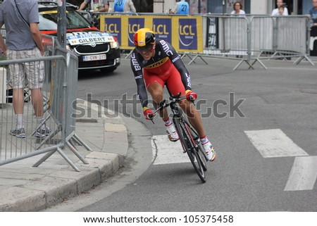"GRENOBLE, FRANCE - JUN 3: Professional racing cyclist Philippe Gilbert rides UCI WORLD TOUR ""CRITERIUM DU DAUPHINE LIBERE"" time trial on June 3, 2012 in Grenoble, France. Luke Durbridge wins the stage - stock photo"