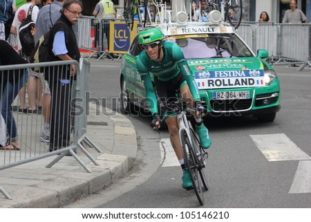 "GRENOBLE, FRANCE - JUN 3: Professional racing cyclist Pierre Rolland rides UCI WORLD TOUR ""CRITERIUM DU DAUPHINE LIBERE"" time trial on June 3, 2012 in Grenoble, France. Luke Durbridge wins the stage - stock photo"