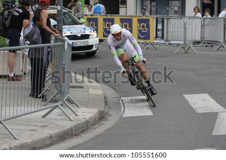 """GRENOBLE, FRANCE - JUN 3: Professional racing cyclist Roger Kluge rides UCI WORLD TOUR """"CRITERIUM DU DAUPHINE LIBERE"""" time trial on June 3, 2012 in Grenoble, France. Luke Durbridge wins the stage - stock photo"""