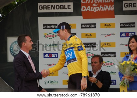 """GRENOBLE, FRANCE - JUNE 8: Professional racing cyclist Bradley Wiggins wears leader yellow jersey of UCI WORLD TOUR """" CRITERIUM DU DAUPHINE LIBERE"""" time trial on June 8, 2011 in Grenoble, Isere France. - stock photo"""