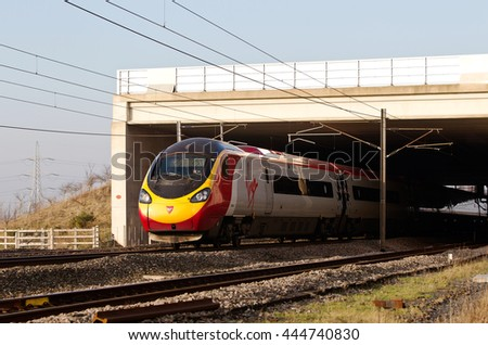 GRETNA, UK - JANUARY 22: A Virgin operated class 390 express train heads toward Carlisle on January 22, 2015 in Gretna. 57 class 390 Pendolinos were built, with one being scrapped after a derailment.