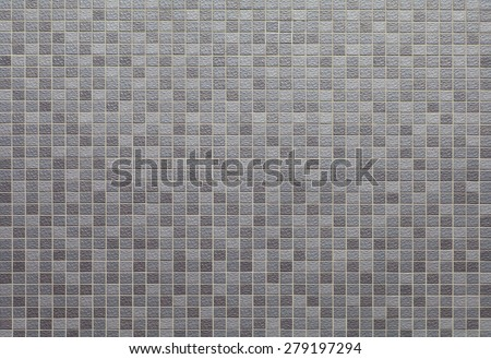 Grey and black mosaic wall texture and background - stock photo