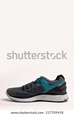 grey and blue(emerald green) running shoes side view isolated white. - stock photo