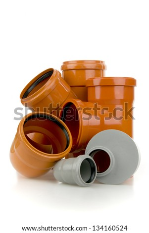 Grey and orange pieces- drain pipe on white background - stock photo