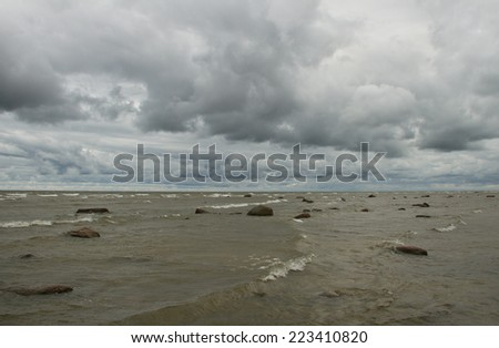 Grey Baltic sea in a cloudy day. - stock photo