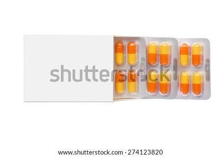 Grey box with orange pills in a blister pack on an isolated background - stock photo