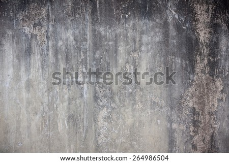 grey cement wall background with a grungy surface weathered and scratched over time - stock photo