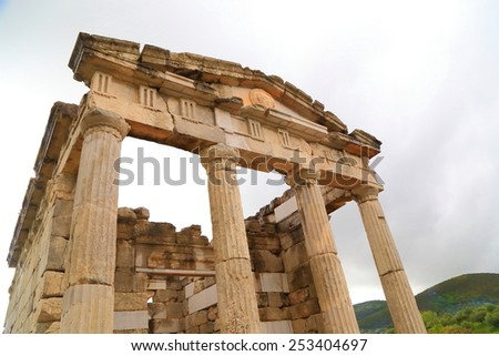 Grey clouds above ancient temple ruins in Messene, Greece